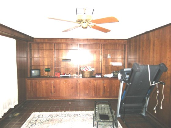 OK it isn't really a workout room.  It's a family room, but someone was clearly using it to store crap.
