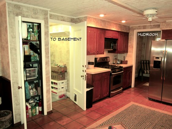 This view of the kitchen is to the left of the above photo.  Off of the kitchen you can access the Mudroom and the Basement (through a pantry).  Don't be jealous of that wallpaper!