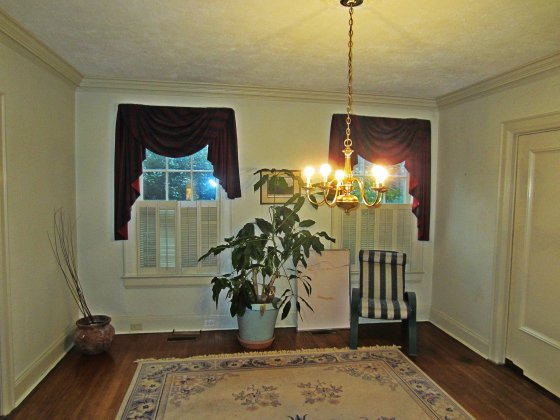 The Dining Room: We definitely kept the drapes. And the Plant. And the Chandelier. OK I'm lying, of course. But the chandy is still there - taunting me about not being able to afford it's replacement.